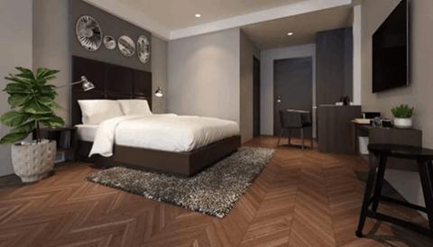 chevron wood flooring in bedroom