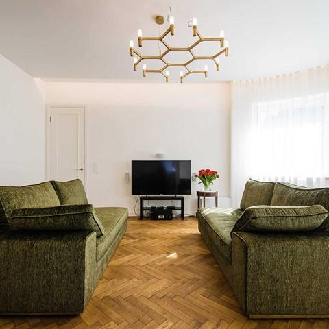 herringbone wood flooring in a living room