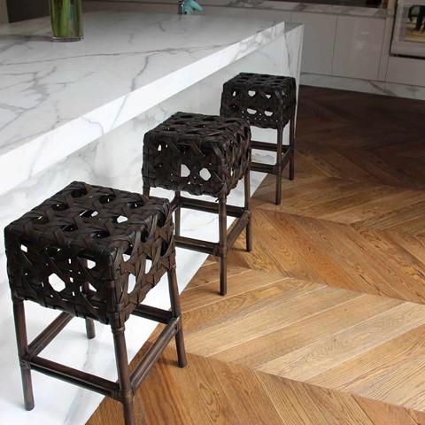 chevron flooring with dining stools